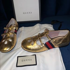 CHILDRENS gold metallic leather shoes with web
